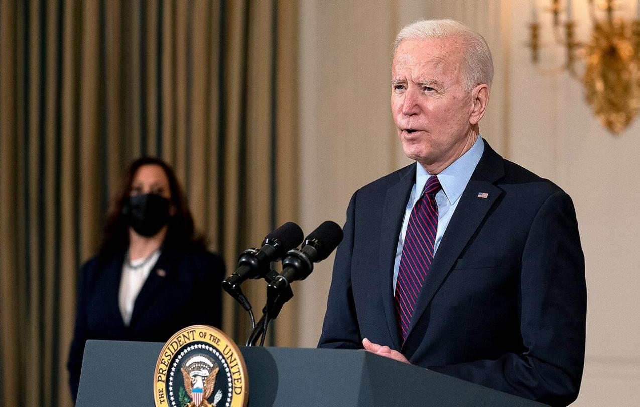Biden speaking at podium and Karris behind him