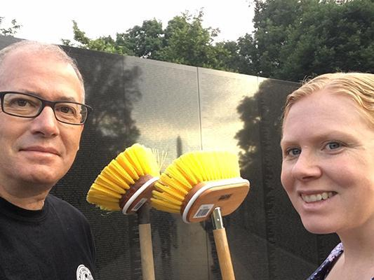 Gerry and his wife Melissa washing the Vietnam Veterans Memorial